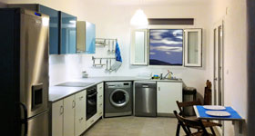 A fully equipped kitchen with oven and ceramic top, microwave,multi coffee machine, water boiler, toaster, pots and pans, dish washer, washing machine, refrigerator/freezer.